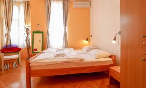 Krevet ili kreveti u jedinici u objektu Pigeon Square Rooms
