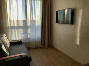 Телевизор и/или развлекательный центр в Apartment Floor 11