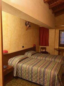 Letto o letti in una camera di Hotel Sarre