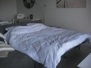 A bed or beds in a room at Bellevue Chez Marilla