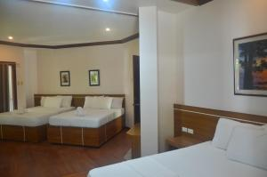 A bed or beds in a room at Robinland Vacation Home