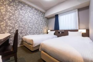 A bed or beds in a room at Hotel WBF Kitasemba WEST