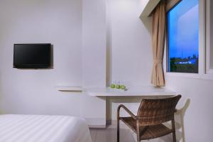 A television and/or entertainment centre at favehotel Diponegoro