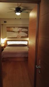 A bed or beds in a room at Mario's Garni