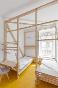 A bunk bed or bunk beds in a room at Flow Hostel