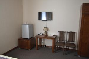 A television and/or entertainment center at Hotel Lazurit