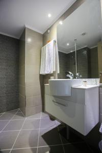A bathroom at Grand Hotel Riga