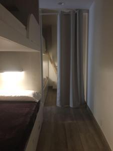 A bunk bed or bunk beds in a room at Albergue-Hostel Atseden