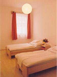 A bed or beds in a room at Rézkakas Fogadó