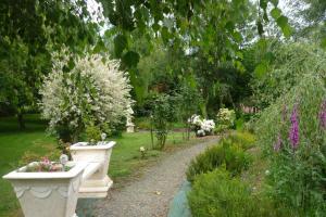 A garden outside Mobile Home Le Clos de See