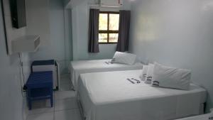 Cama ou camas em um quarto em Hotel Serrador