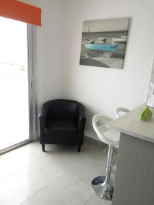 Predel za sedenje v nastanitvi Elenapa Holiday Apartments