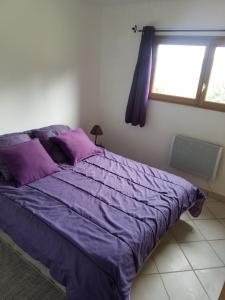 """A bed or beds in a room at Gites """"Le Bret"""""""