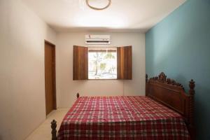 A bed or beds in a room at Casa de Praia Mico Leão