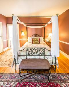 A bed or beds in a room at The Black Walnut Inn