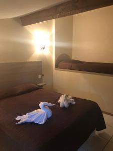 Un ou plusieurs lits dans un hébergement de l'établissement Hotel Clair de Lune