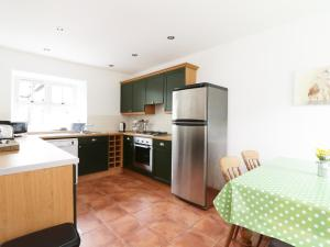 A kitchen or kitchenette at Dunnottar Woods House, Stonehaven