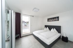 Ein Bett oder Betten in einem Zimmer der Unterkunft Hotel Restaurant Sailer