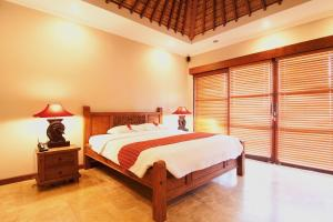 A bed or beds in a room at Ajanta Villa