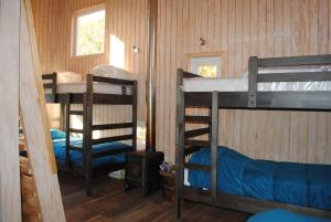 A bunk bed or bunk beds in a room at Casa Negra Nevados de Chillan