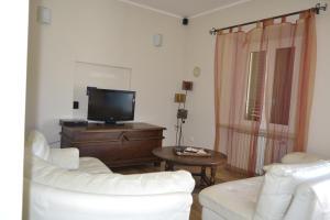 TV o dispositivi per l'intrattenimento presso Vigne Apartament
