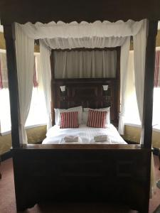 A bed or beds in a room at Tyr Graig Castle