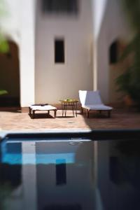 The swimming pool at or near Riyad El Cadi