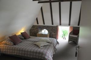 Een bed of bedden in een kamer bij B&B 1874