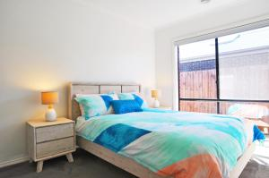 A bed or beds in a room at PLOVERS REST - SURF SIDE