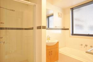 A bathroom at SUNSET WATERS - INLET SIDE