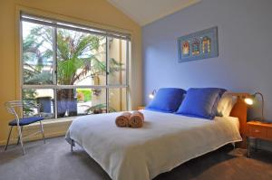 A bed or beds in a room at THE SAILS 4 - CENTRAL LOCATION