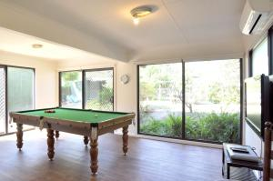 A pool table at WAVELENGTH - WIFI & PET FRIENDLY (OUTSIDE ONLY)