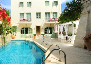 The swimming pool at or near Mythos Suites Hotel