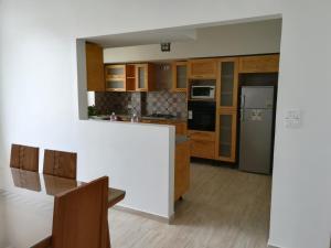 Cuisine ou kitchenette dans l'établissement Espadon De Mahdia - Etage de Villa