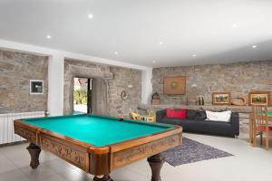 A pool table at Casas de Sequeiros