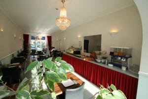 Restaurant ou autre lieu de restauration dans l'établissement Hotel Duinzicht