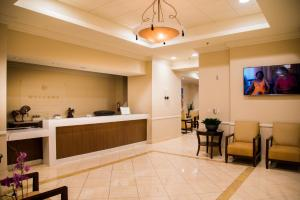 The lobby or reception area at Polo Towers by Raintree