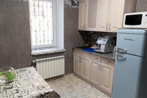 A kitchen or kitchenette at Art house Hostel