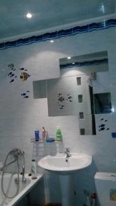 A bathroom at Apartments on Orbitalnaya