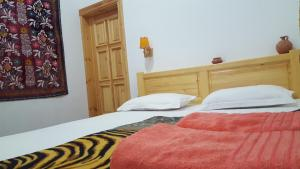 A bed or beds in a room at Amir Hostel