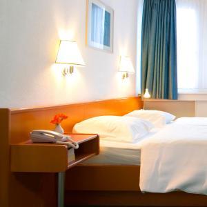 Кровать или кровати в номере Hotel Francais