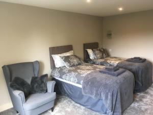 A bed or beds in a room at Eccleshall Bed and Breakfast
