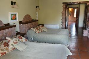A bed or beds in a room at La Casa De La Bodega - Wine Boutique Hotel