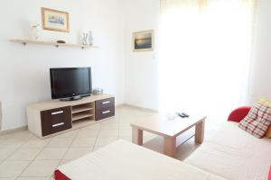 A television and/or entertainment center at Apartments Maras