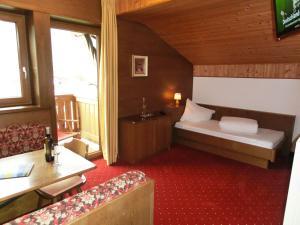 Ein Bett oder Betten in einem Zimmer der Unterkunft Pension Sattlerenglhof
