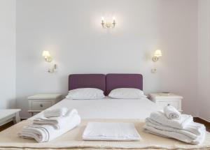 Letto o letti in una camera di Malion Rooms