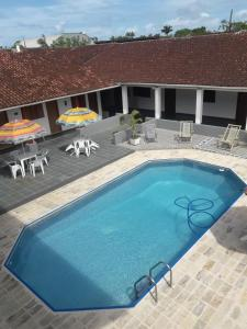 The swimming pool at or near Pousada Por do Sol