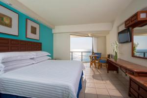 A bed or beds in a room at Barceló Ixtapa - All Inclusive