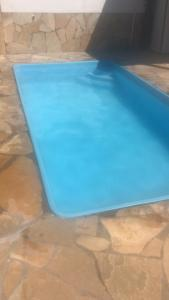 The swimming pool at or near Pousada Recanto das pedras