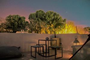 A balcony or terrace at Riad DAR HOME